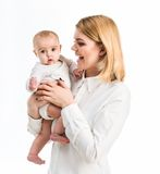 Young mother with her six-month daughter Stock Photos