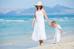 Young mother with her son on beach vacation Royalty Free Stock Photography