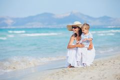 Young mother with her son on beach vacation Royalty Free Stock Images