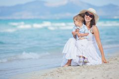 Young mother with her son on beach vacation Royalty Free Stock Photos