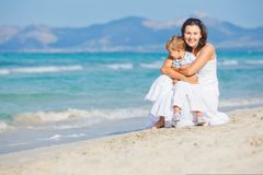 Young mother with her son on beach vacation Stock Photo