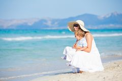 Young mother with her son on beach vacation Stock Image