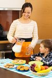 Young mother and her son on a kitchen Stock Photography