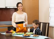 Young mother and her son on a kitchen Royalty Free Stock Photos