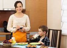 Young mother and her son on a kitchen Royalty Free Stock Image