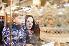 Young mother with her son looking at an exhibit in a museum royalty free stock image