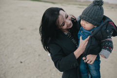Young mother and her son outdoor Stock Photo