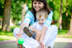 Young mother with her son in park Stock Photography