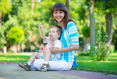Young mother with her son in park Royalty Free Stock Photos