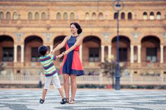 Young mother and her son playing outdoors in city. Young mother and her son playing outdoors, Sevilla, Spain Royalty Free Stock Image
