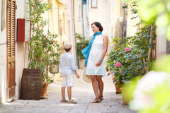 Young mother and her son playing outdoors in city. Young mother and her son playing outdoors in mediterranean city Royalty Free Stock Photo