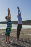 Young mother with her son practicing yoga Stock Photography