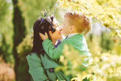 Young mother and her son spending time outdoor Stock Photo