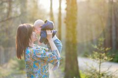 Young mother with her son in a spring forest Royalty Free Stock Photos