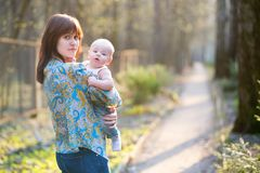 Young mother with her son in a spring forest Royalty Free Stock Photo
