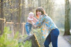 Young mother with her son in a spring forest Royalty Free Stock Image