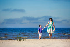 Young mother and her son on summer vacation Royalty Free Stock Photo