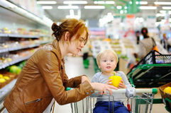 Young mother and her son in a supermarket Stock Images