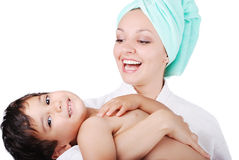 Young mother and her son after taking a bath. The Young mother and her son after taking a bath Royalty Free Stock Photography