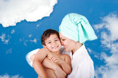 Young mother and her son after taking a bath. In the sky Royalty Free Stock Images