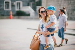 Young mother and her son walking in city Royalty Free Stock Photos