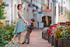 Young mother and her son walking outdoors in city Royalty Free Stock Photography
