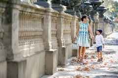 Young mother and her son walking outdoors in city Stock Photo
