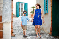 Young mother and her son walking outdoors in city Stock Photos