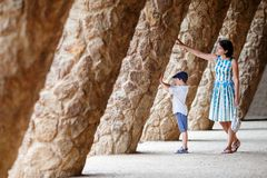 Young mother and her son walking Park Guell. Barcelona Royalty Free Stock Photography