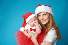 Young mother with her sweet baby. Happy young mother with her sweet baby Royalty Free Stock Photos