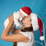 Young mother with her sweet baby. Happy young mother with her sweet baby Stock Image