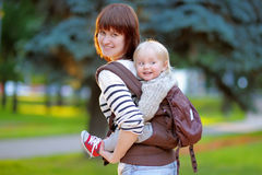 Young mother with her toddler child stock photos