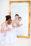 Young mother and her toddler daughter next mirr Royalty Free Stock Images