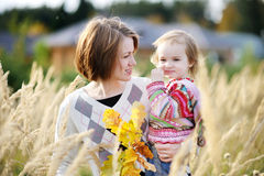 Young mother and her toddler girl in autumn Stock Image
