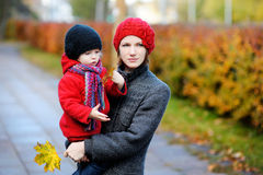 Young mother and her toddler girl in autumn Royalty Free Stock Photography