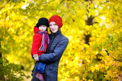 Young mother and her toddler girl in autumn Stock Images