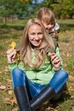 Young mother and her toddler girl in autumn Royalty Free Stock Photo