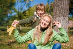 Young mother and her toddler girl in autumn Stock Photo
