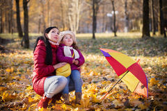 Young mother and her toddler girl in autumn Royalty Free Stock Photos