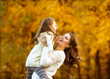 Young mother and her toddler girl  fun Royalty Free Stock Photos