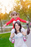Young mother and her toddler girl have fun in autumn Royalty Free Stock Images