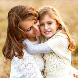 Young mother and her toddler girl have fun, mother's Day. Stock Images