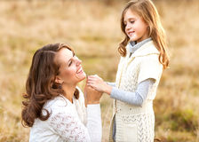 Young mother and her toddler girl have fun, mother's Day. Stock Photo
