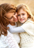 Young mother and her toddler girl have fun, Stock Image