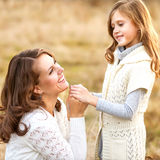Young mother and her toddler girl have fun Stock Photography