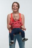Young mother and her toddler son having fun Royalty Free Stock Photography