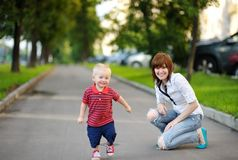 Young mother with her toddler son Royalty Free Stock Photos