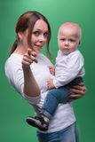 Young mother and her toddler son pointing at Royalty Free Stock Photos