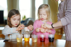 Young mother and her two daughters painting Easter eggs Royalty Free Stock Image