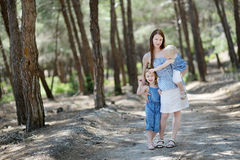Young mother and her two daughters at summer day Stock Photo